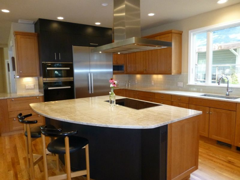 Close up of a kitchen with sink on island