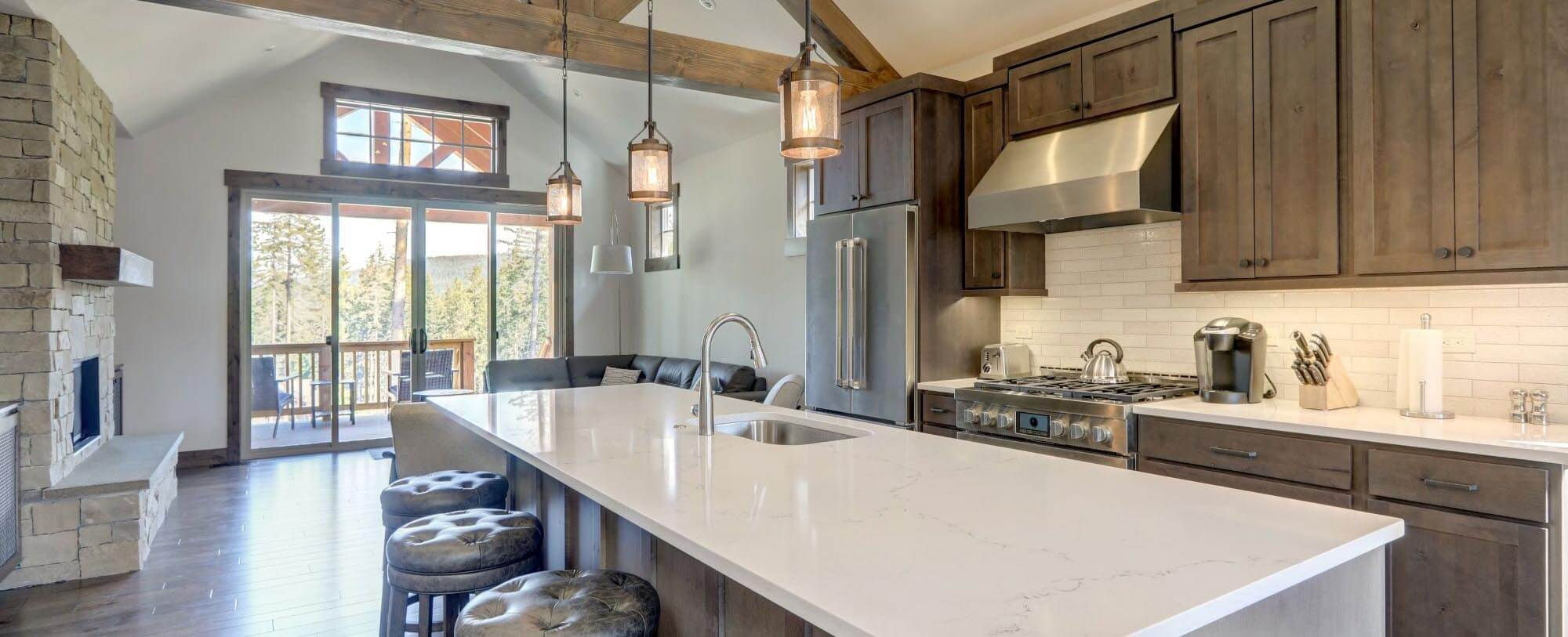Large Kitchen with Dark Cabinets and Large Marble Island